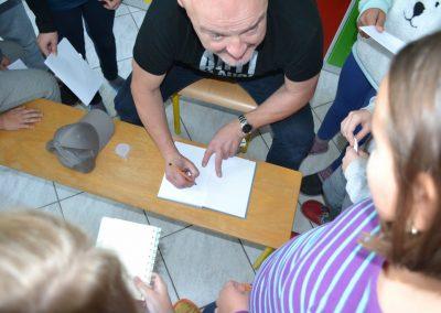 31_Obisk pisatelja Primoža Suhodolčana_r